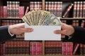 Man Hands Passing Bribe In Env...