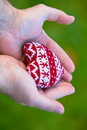 Man hands with red knitted heart Royalty Free Stock Photo