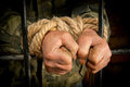 Man with hands tied up with rope Stock Image
