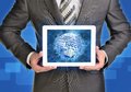 Man hands using tablet pc. Earth, money and Royalty Free Stock Photo