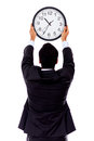 Man hanging a clock Royalty Free Stock Photos