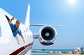 Man hanging out flying airplane window Royalty Free Stock Photo