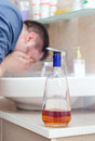 Man with hangover washing up Royalty Free Stock Images