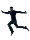 Man happy jumping saluting silhouette full length Royalty Free Stock Image