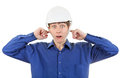 Man in hard hat with closed ears shocked young isolated on the white background Stock Image