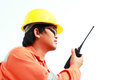 Man in hard hat using walkie talkie for comunication Stock Photography