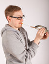 A man has a fish in his hand Royalty Free Stock Image