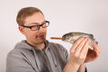 A man has a fish in his hand Stock Photography