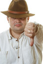 Man in hat lowers downwards big finger Royalty Free Stock Photo