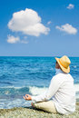 Man with hat meditation Royalty Free Stock Photos