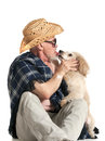 Man in a hat sitting with a poodle on white background Royalty Free Stock Images
