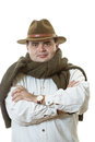 Man in hat white shirt and sweater tied up round neck Stock Photography