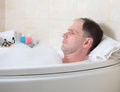 Man having a bath Stock Photography