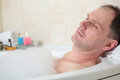 Man having a bath Royalty Free Stock Image