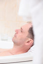 Man having a bath Stock Image