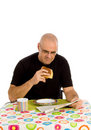 Man having breakfast Stock Images