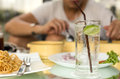 Man having glass of fresh sparkling mineral water Royalty Free Stock Photo