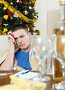 Man having hangover during holidays at home christmas Stock Photography
