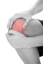 Man having knee injury close up of suffering from on white background Stock Photography