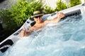Man having massage in hot tub spa. Royalty Free Stock Photo