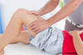 Man having thigh massage in medical office Stock Photography