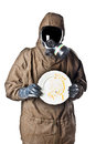 Man in hazard suit holding a dirty dish wearing an nbc suite nuclear biological chemical Royalty Free Stock Photo