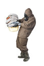 Man in hazard suit holding dirty towels a wearing an nbc suite nuclear biological chemical Royalty Free Stock Images