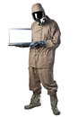 Man in hazard suit holding a laptop wearing an nbc suite nuclear biological chemical Stock Photo