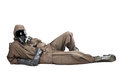 Man in hazard suit layng on the ground a wearing an nbc suite nuclear biological chemical Stock Photography