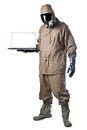 Man in hazard suit showing a laptop wearing an nbc suite nuclear biological chemical Royalty Free Stock Images