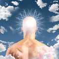 Man with head in clouds radiates electric Stock Photo