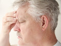 Man with headache over eye Royalty Free Stock Photos