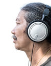 Man and headphone in action of listening Royalty Free Stock Photos