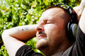 Man with headphones listening music Royalty Free Stock Photos