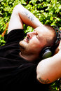 Man with headphones listening music Royalty Free Stock Images