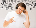 Man with headphones listening rock music and technology young Stock Images