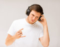 Man with headphones listening rock music young Royalty Free Stock Photo