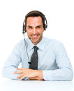 Man with headset leaning on his desk Royalty Free Stock Photo