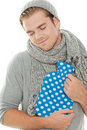 Man with heating pad smiling Royalty Free Stock Images