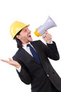Man with helmet and loudspeaker on white Royalty Free Stock Images