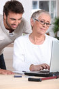 Man helping old lady Stock Images