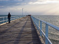Man on Hervey Bay jetty Royalty Free Stock Photo
