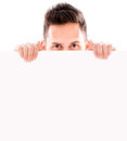 Man hiding behind banner a isolated over white background Royalty Free Stock Image