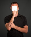 Man hiding behind a blank note Stock Photography