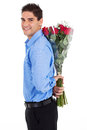 Man hiding roses Royalty Free Stock Photography
