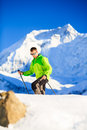 Man hiker or climber accomplish in winter mountains inspiration and motivation achievement business concept success climbing on Stock Image