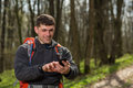 Man hiker taking photo with smart phone in forest Royalty Free Stock Photo