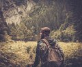 Man hiker walking in mountain forest