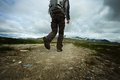 Man hiker walking towards mountain Stock Photos