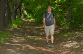 Man hikes at summer forest Royalty Free Stock Photo